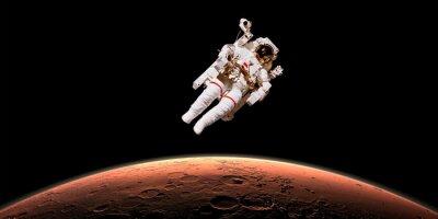 Naklejka Astronauta w przestrzeni kosmicznej na Marsa. Elementy obrazu są urządzone przez NASA