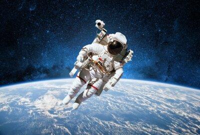 Naklejka Astronauta w przestrzeni kosmicznej z planety Ziemia w tle. Elementy