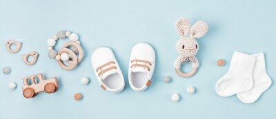 Naklejka Baby shoes and teethers banner. Organic newborn accessories, branding, small business idea.