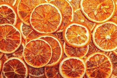 Naklejka Background created from dry orange slices in random order.