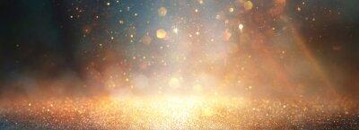 Naklejka background of abstract glitter lights. gold, blue and black. de focused