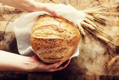 Naklejka Baker gospodarstwa bochenek chleba na tamtejsze Bacgkround
