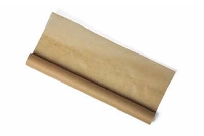Naklejka Baking paper roll isolated on white background. Brown parchment in a roll. Baking paper roll
