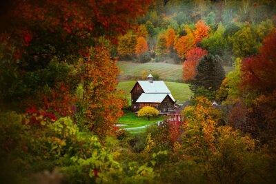 Naklejka Barn in rural Vermont nestled between fall foliage