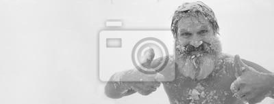 Naklejka Bearded man, after bathing in the snow