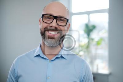 Naklejka Bearded middle-aged man wearing glasses.