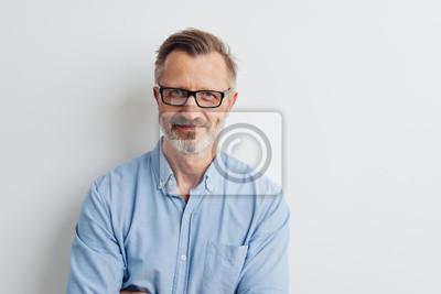 Naklejka Bearded middle-aged man wearing glasses