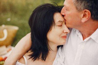 Naklejka Beautiful adult couple spend time in a summer field