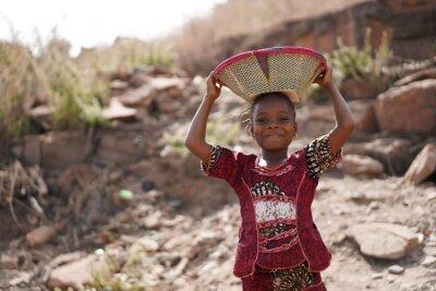 Naklejka Beautiful African Black Girl Carrying Food for Life