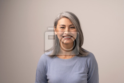 Naklejka Beautiful Asian woman with a stunning smile