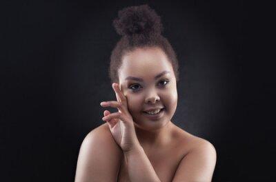 Naklejka Beautiful black african woman face studio portrait.