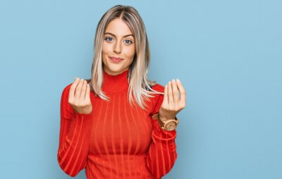 Naklejka Beautiful blonde woman wearing casual clothes doing money gesture with hands, asking for salary payment, millionaire business