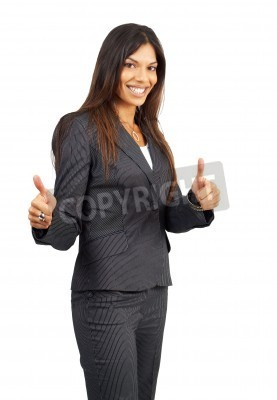 Naklejka Beautiful brunette businesswoman in pinstripe suit giving thumbs up. Isolated on white background with copy space