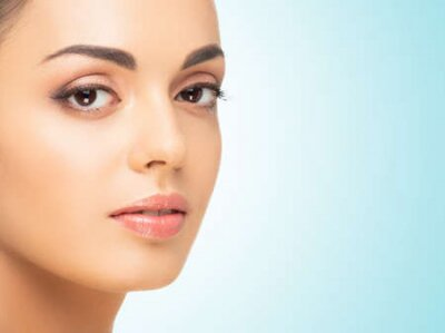 Naklejka Beautiful face of young and healthy woman. Spa, cosmetology and healthcare.