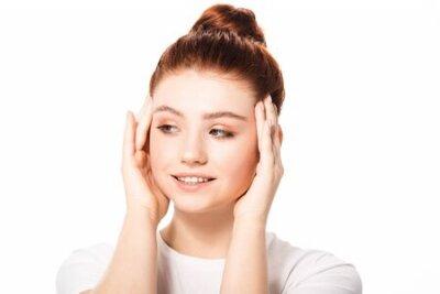 Naklejka beautiful smiling female teenager with clean skin, isolated on white