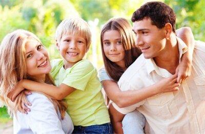 Naklejka Beautiful smiling Lovely family on background