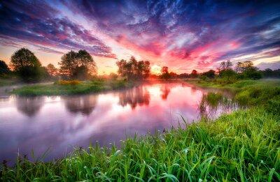 Naklejka Beautiful summer sunrise over river banks