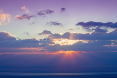 Beautiful sunrise over the Judaean desert. Morning sky with clouds and sun. Israel