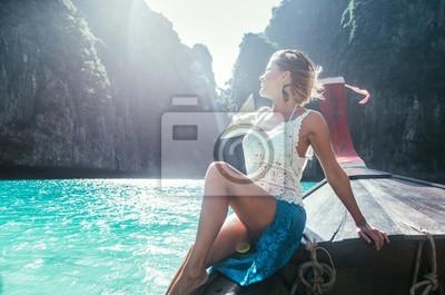 Naklejka Beautiful woman making an excursion to phi phi island and maya beach in Thailand