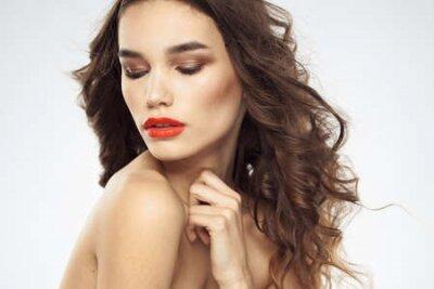 Naklejka Beautiful woman with drawn swords bright makeup glamor close-up light background