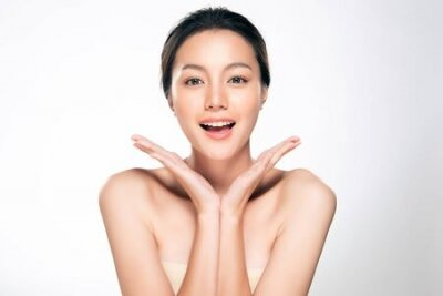 Naklejka Beautiful Young Asian Woman with Clean Fresh Skin. Face care, Facial treatment, Cosmetology, beauty and spa,