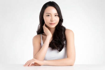 Naklejka Beautiful Young asian Woman with Clean Fresh Skin, on white background, Face care, Facial treatment. Cosmetology, beauty and spa. Asian women portrait