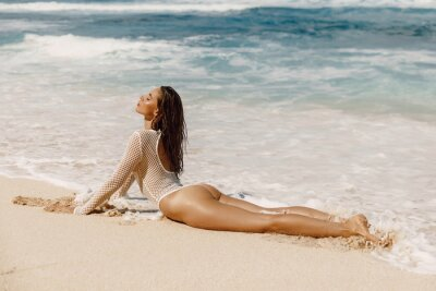 Naklejka Beautiful young woman in bikini relax at tropical beach. Sexy model at ocean coast