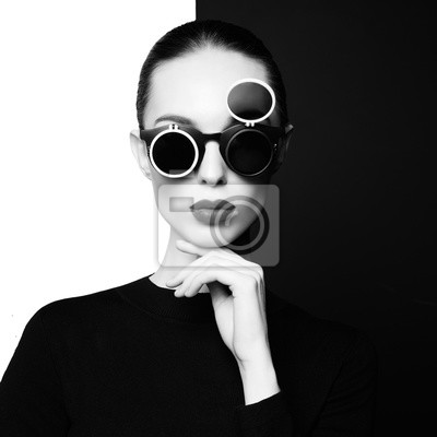 Naklejka beautiful young woman with black sunglasses