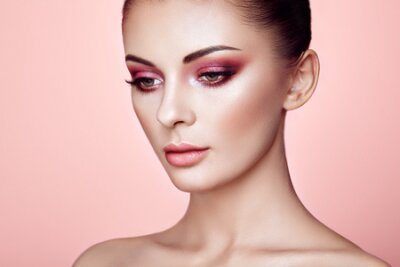 Naklejka Beautiful Young Woman with Clean Fresh Skin. Perfect Makeup. Beauty Fashion. Eyelashes. Cosmetic Eyeshadow. Highlighting. Cosmetology, Beauty and Spa