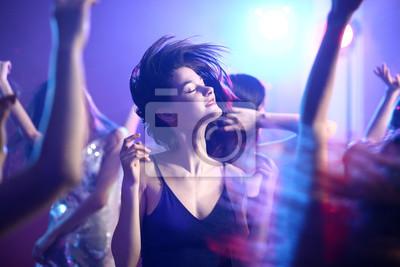 Naklejka Beautiful young women dancing in night club