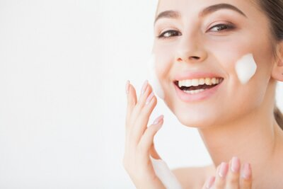 Naklejka Beauty Face Care. Woman With Cream On Facial Skin