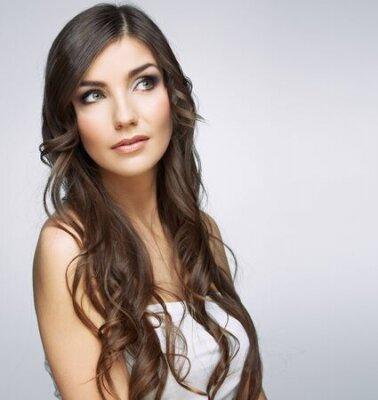 Naklejka Beauty woman face close up portrait. Girl with long hair looking up side. Female model studio portrait.