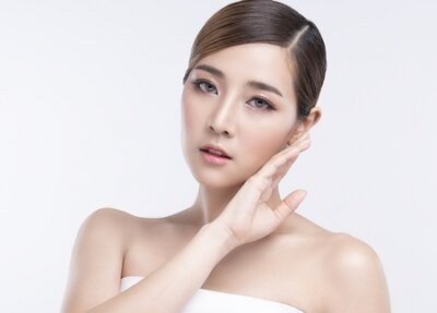 Naklejka Beauty Young asian woman with perfect facial skin. Gestures for advertisement treatment spa and cosmetology.
