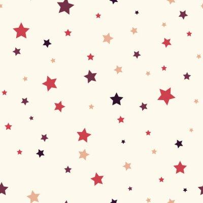Naklejka Bez szwu tła z kolorowych gwiazd. Jednolite wektora wzór z kolorowych gwiazd o ró? Nych rozmiarach na bia? Ym tle.