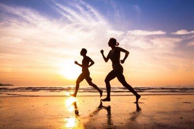 Naklejka Biegacze na plaży, sportu i zdrowego stylu życia