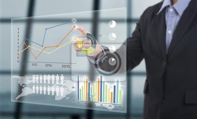 Naklejka Biznesmen dotykając finansowe wykres z analizy kluczowych wskaźników wydajności na wirtualnym ekranie.