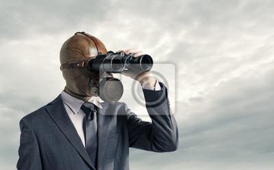 Naklejka Biznesmen z maską gazową, patrząc przez lornetkę