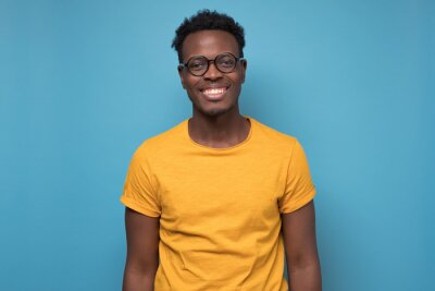 Naklejka Black african american young man in yellow t-shirt with cheerful attitude