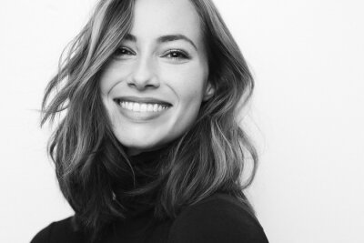 Naklejka Black and white portrait of young happy woman with a big smile on her face