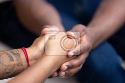 Naklejka Black man friend holding hands of african woman, closeup view