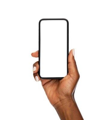 Naklejka Black woman hand holding modern smart phone isolated on white background