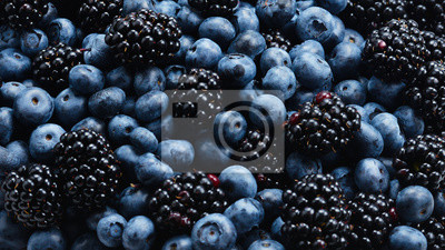 Naklejka Blackberry and  blueberry background. Top view.