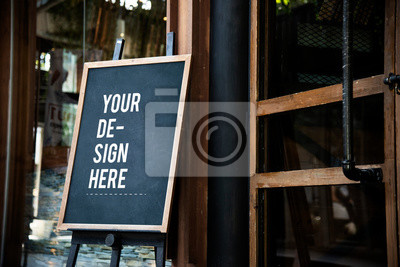 Naklejka Blackboard sign mockup in front of a restaurant