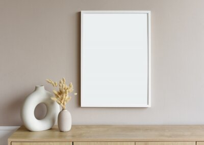 Naklejka Blank picture frame mockup on gray wall. White living room design. View of modern scandinavian style interior with artwork mock up on wall. Home staging and minimalism concept