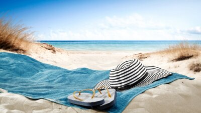 Naklejka blue towel with hat and summer beach