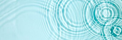 Naklejka Blue water texture, blue mint water surface with rings and ripples. Spa concept background. Flat lay, copy space.
