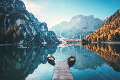 Naklejka Boats on the Braies Lake ( Pragser Wildsee ) in Dolomites mountains, Sudtirol, Italy