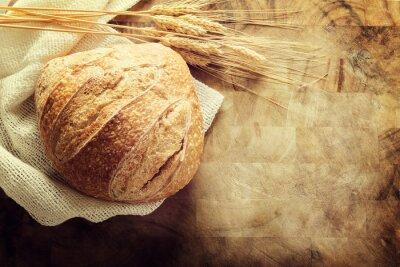 Naklejka Bochenek chleba na pokładzie rozbioru rustykalnym tle