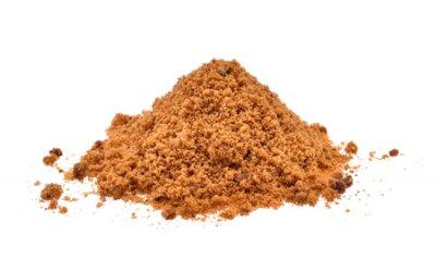 Naklejka brązowy cukier na białym tle