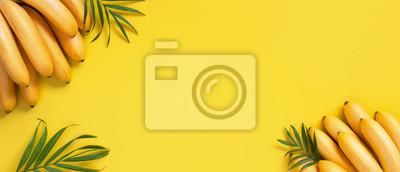 Naklejka Bright yellow background with bunch of bananas